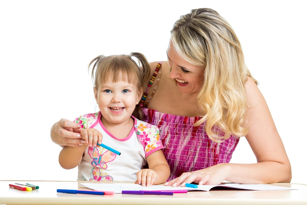 girl-drawing-with-mother